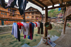 Wet laundry drying on hangers under cover outdoors, Guizhou, Chi Stock Photos