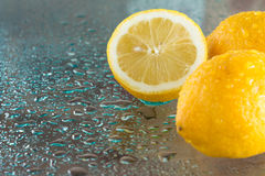 Wet lemons Stock Image