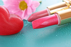 Wet lipsticks stock photography