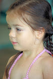 Wet Little girl in her bathing suit. Little boy is wet after swimming in the pool and sitting in her bathing suit Stock Image