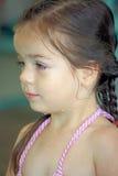 Wet Little girl in her bathing suit stock image