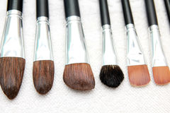 Wet make up brushes on towel Stock Photos