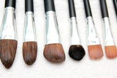 Wet make up brushes on towel Stock Photos