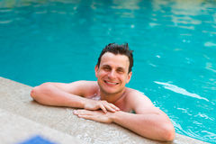 Wet man posing in the swimming pool Stock Images