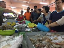 Wet Market In Malaysia. Bargaining seafood in a wet market Stock Image
