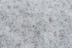 Wet melting dirty, contaminated granular or firn snow texture, p Stock Photography