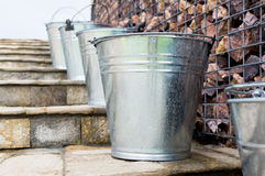 Wet Metal Buckets on stairs Stock Images