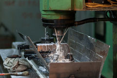 Wet milling process. Wet стс milling process in old machine Stock Photography