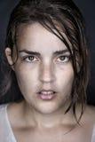 Wet model face. Woman portrait fine art wet face conceptual headshot Stock Photography