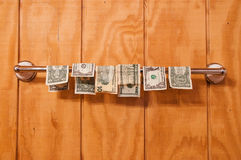 Wet money drying Royalty Free Stock Images