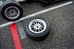 Wet motor sport racing tire on circuit track Stock Images