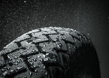 Wet motorcycle tire tread. Close-up shot of classical motorcycle tire tread in wet weather condition Royalty Free Stock Images