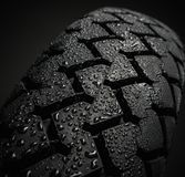 Wet motorcycle tire tread Stock Photos