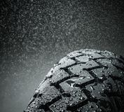 Wet motorcycle tire tread Royalty Free Stock Images