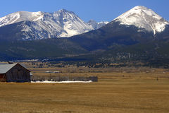 The Wet Mountain Valley. Several 14,000 foot peaks of the mighty Sangre De Cristo Mountains soar nearly 7000 feet above the Wet Mountain Valley near Westcliffe Stock Photo