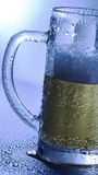Wet mug of beer Stock Images