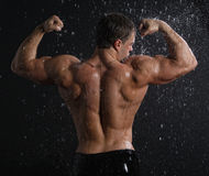Wet muscle young man back under the rain Stock Photo