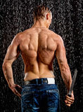 Wet muscle sexy young man back under the rain Royalty Free Stock Images