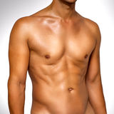 Wet male muscular torso Stock Images