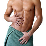 Wet Muscular Torso Wrapped in Towel Royalty Free Stock Image