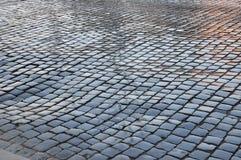 Wet old european city cobblestone pavement after the rain. Stock Images