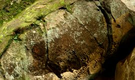 Wet old rocks with moss. Stones and rockes with moss, wet, solid and massive. Good as background Stock Image