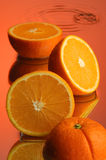Wet orange #1. Orange, water and mirror surface Royalty Free Stock Image