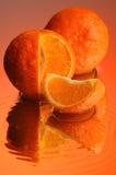 Wet orange #3. Orange, water and mirror surface Stock Image