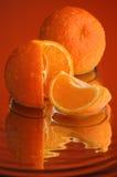 Wet orange #5. Orange, water and mirror surface Stock Photos