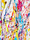 Paint splatter. Abstract paint splatter on wood background