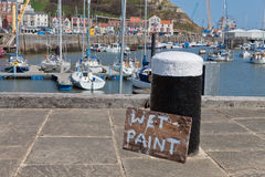 Wet Paint. Sign on a Peace of Wood in a Harbour Stock Photography