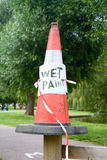 Wet paint sign on traffic cone Stock Photography