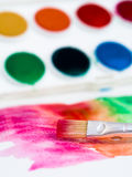 Wet painting. Wet rush making strokes - painting with water colors Stock Photography