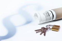 Wet, paragraaf, huurwet, hangslot en sleutels, de bouw wet, bouwplan stock fotografie