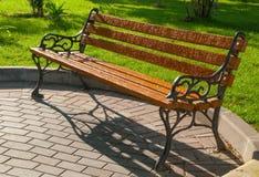 Wet park bench Stock Photos