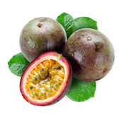 Wet passion fruits with leaves isolated Stock Photo