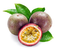 Wet passion fruits with leaves isolated on white Royalty Free Stock Photos