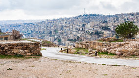 Wet path from Citadel to Amman city in rain. Travel to Middle East country Kingdom of Jordan - wet path from Citadel to Amman city in rain in winter Stock Photo