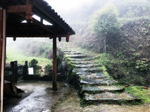 Wet path near country house in Tiantou village. Travel to China - wet path near country house in Tiantou village in area Dazhai Longsheng Rice Terraces (Dragon's Stock Images