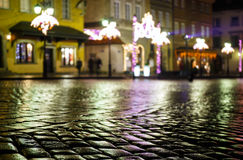 Wet pavement and festively bedecked in Warsaw old town Stock Images