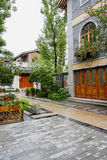 Wet pavement before old-fashioned Chinese building after rain Royalty Free Stock Photo