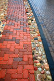 Wet paver pattern. Paver detail on pathway outside in Vilnius,  Lithuania Royalty Free Stock Images