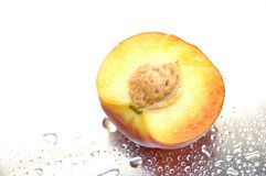 Wet peach. Peach half with droplets Royalty Free Stock Photo