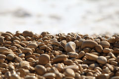Wet pebble against a sea surf Stock Photos