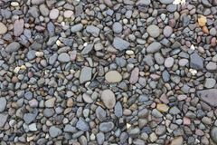 Wet pebble, rocks background Royalty Free Stock Images
