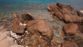 Wet pebble stones in crystal clear sea water close up. Wet pebble stones in the transparent clear calm sea water of the Aegean Sea close up footage. Mykonos stock video