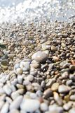 Wet pebbles background. Wet pebbles close-up background in water Stock Photography