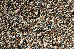 Wet pebbles beach Stock Photo