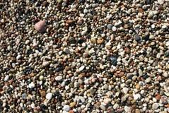 Wet pebbles beach stock photo