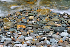 Wet Pebbles on beach. Colourful pebbles on the beach Stock Photography